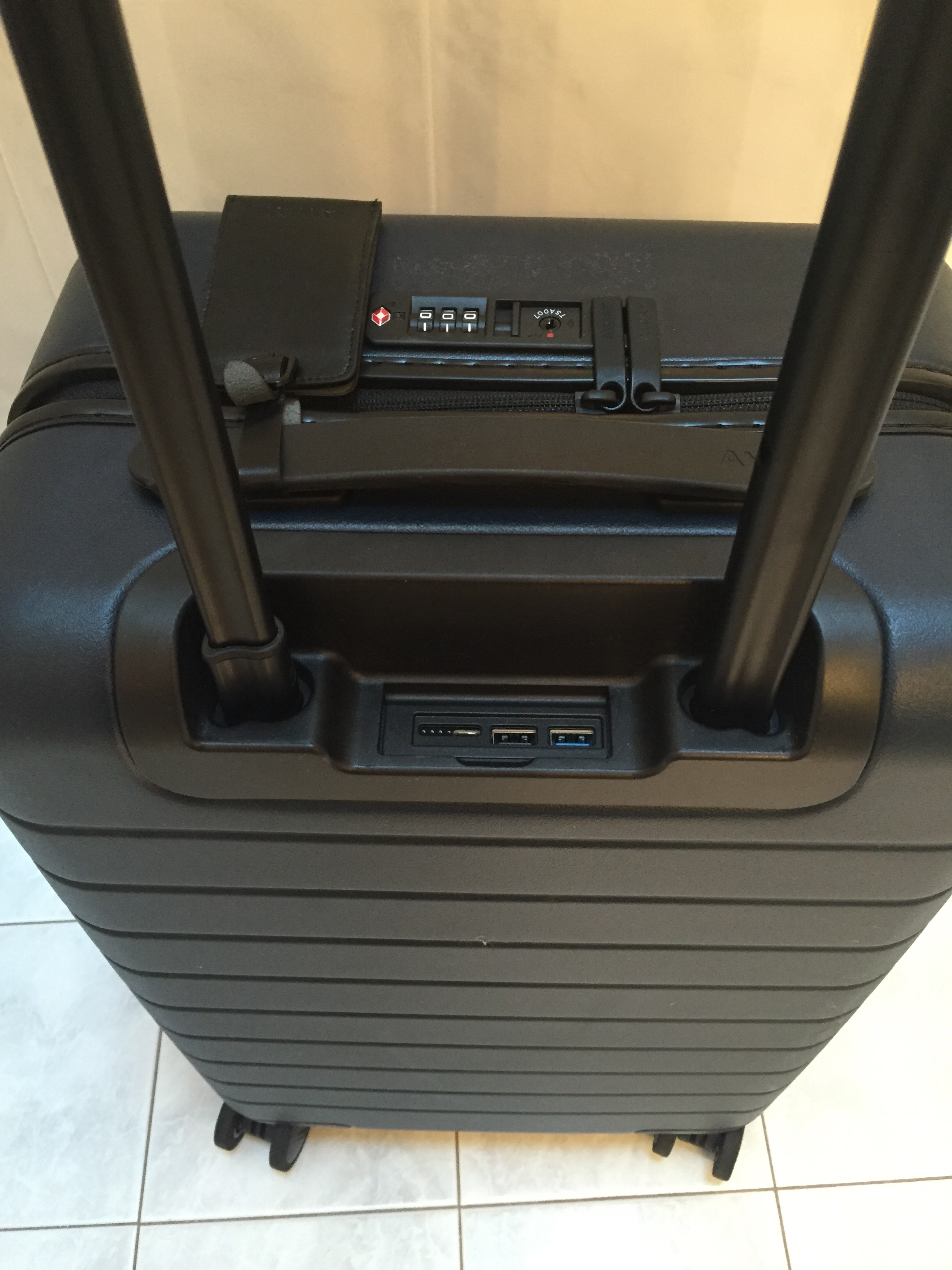 close up photo of away luggage